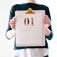 financial calendar being held up