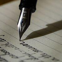 financial planning - pen writing